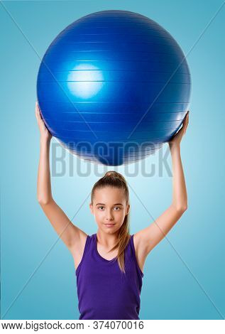 Fitness Woman Holding Exercise Ball During Workout. Beautiful Smiling Happy Caucasian Fit Female Fit