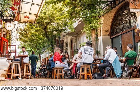 Larissa, Thessaly, Greece - May 4th, 2018: People Sitting Havings Drinks At Monk Cafe At Apollonos S