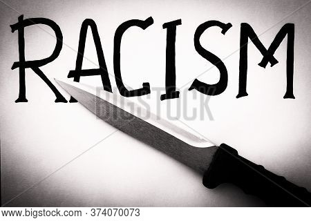 Inscription Racism And Knife On White Background. Ethnic Protest Demanding Stop Racism. Problem Of D