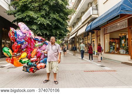 Larissa, Thessaly, Greece - May 4th, 2018: A Male Vendor Selling Ballooms At The Pedestrian Street K