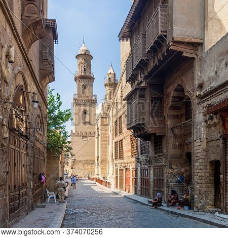 Cairo, Egypt- June 26 2020: Moez Street With Workers, Few Local Visitors And Minaret Of Qalawun Comp