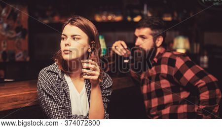 Woman Alcoholic Beverage In Bar. Female Male Alcoholism. Woman And Man Alcoholism. Alcoholism, Alcoh