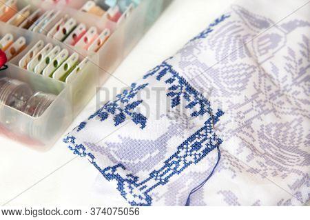 A Close Up Of A Cross Stitch Embroidery. Cross-stitch Ornament