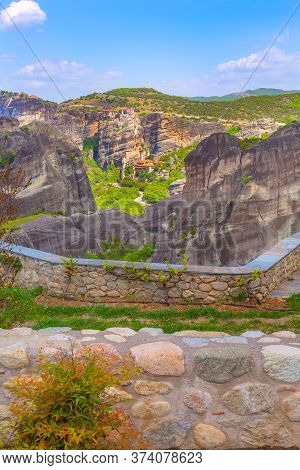 Panoramic View Of Few Meteora Monasteries On The High Cliff Rock In The Mountains At Spring Time, Gr