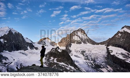 Zinal, Switzerland - July 19, 2019: Full Length Of Woman Hiker Admiring The Fantastic View Of Snow C