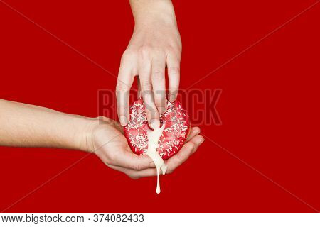 Female Hands And A Donut On A Red Background As A Symbol Of Masturbation And Foreplay (prelude) Befo