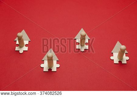 Wooden Figures Working Online In House On Red Background. Freelance Workplace At Home, Teleworking.