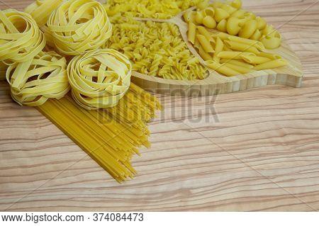 Pasta Nests Spaghetti Scallops Linguini Penne Tagliatelle Fusilli Spirals On A Blackboard And Wooden