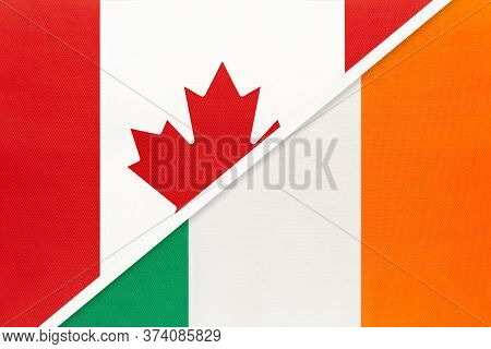 Canada And Ireland, Symbol Of Two National Flags From Textile. Relationship, Partnership And Champio