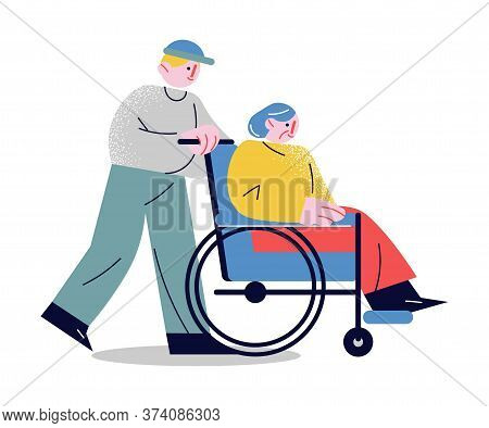 Young Man Rolling Whellchair Helping Elderly Woman To Move