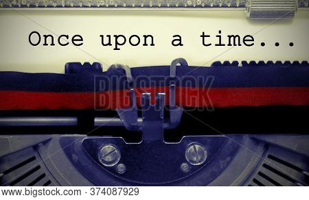 Once Upon A Time Text On White Sheet In Vintage Typewriter With Black And Red Ink Ribbon