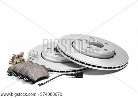 Brand New Brake Discs And Brake Pad Set For Car. Isolated On White With Copy Space.
