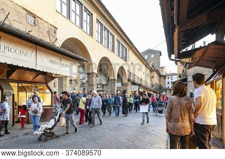 Florence, Italy - October 2019: Tourists Walking On The Famous Ponte Vecchio (old Bridge), A Medieva
