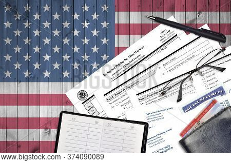 Uscis Form I-140 Immigrant Petition For Alien Workers Lies On Flat Lay Office Table And Ready To Fil