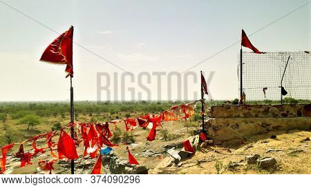 Hindu Religious Red Flags Fluttering On Temple On A Hill And Horizon View Point