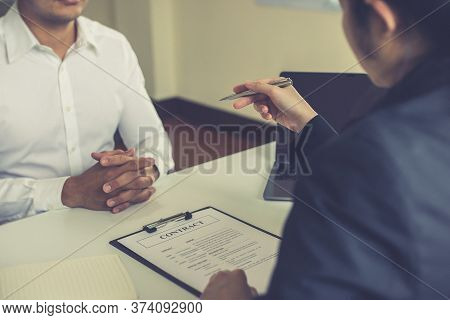 Managers or HR departments read resume and interview applicants for selection as a company real esta