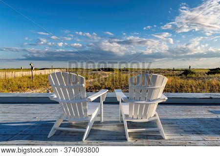 Cape Cod Beach With Beach Chairs On At Sunset, Cape Cod, Massachusetts, Usa.
