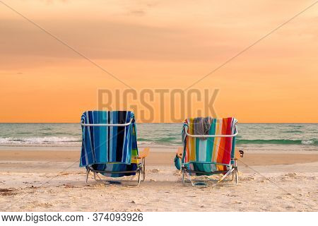 Sunset Beach View Of Beach Lounge Chairs With Towels In Siesta Key Beach Of Florida Gulf Coast, Usa