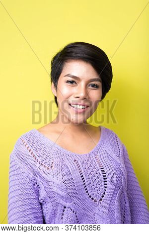 Portrait Of Happy Young Asian Woman With Short Hair Smiling