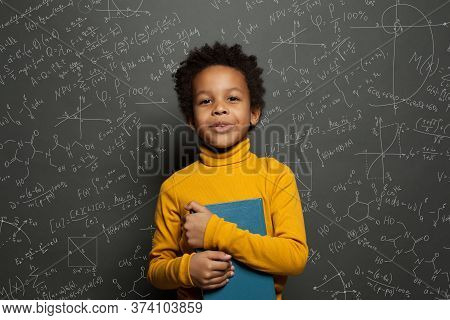 African American Child Student On Blackboard Background With Science And Maths Formulas