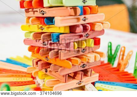 Clothes Pegs,  Multicolored Clothespins Are Arranged, Lined In Artistic Shape.
