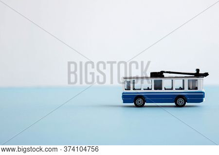 Small Toy Blue And White Trolley, Place For Text 1