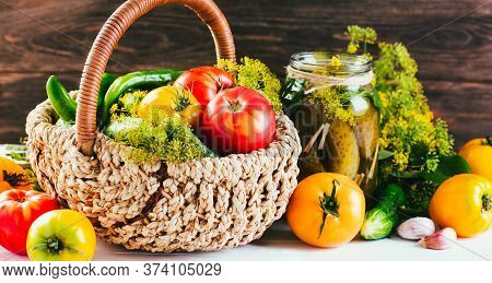 Harvesting Seasonal Vegetables, Cucumbers, Tomatoes, Peppers And On A Wooden Background