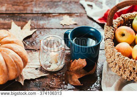 Autumn Harvest. Pumpkin Apples And Tea On The Window. Cozy House