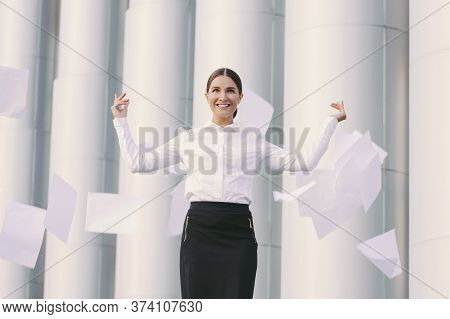 Beautiful Cheerful Girl Student Lawyer Celebrate Success And Throw Documents Away In Air Outdoors. Y