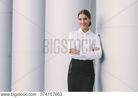 Portrait Beautiful Young Girl Boss Professional Entrepreneur Keep Arms Crossed And Smile Outdoors. A
