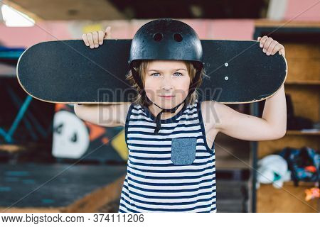 Skateboarder Boy In Helmet Posing In Skate Park. Kid Boy With Skateboard. Childhood, Leasure, Lifest