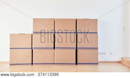 Many moving boxes on wall after an office move with moving company or freight forwarder