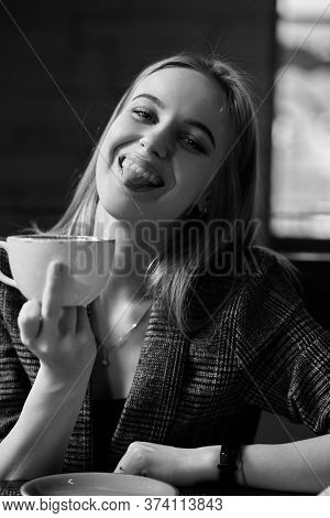 Ironical Fun Young Woman With A Teacup Shows Fuck Gesture Looks At The Camera, Monochrome