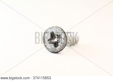 Close-up On Screws, Metal Screws, Iron Screws, Wood Screws Isolated On White Background