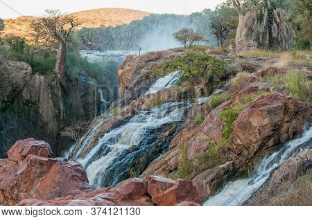 Part Of The Epupa Waterfalls In The Kunene River At Sunset. Baobab Trees Are Visible