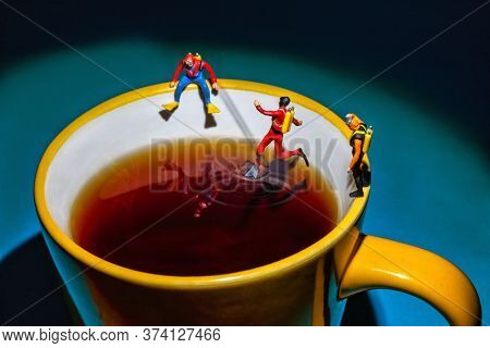 recreation activities, miniature divers diving in a hot steamy cup of tea