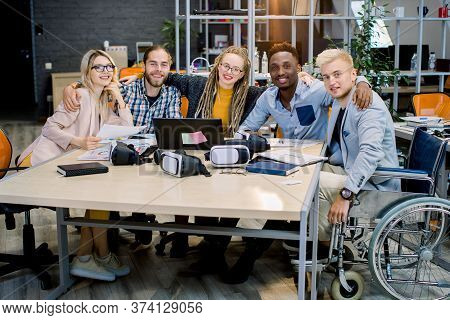 Inclusion In Work, Business Team Concept. Handsome Male Coworker On Wheelchair With His Creative Bus