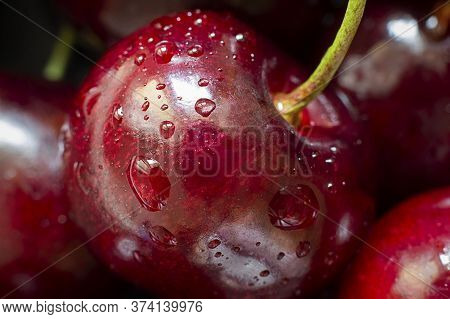 Closeup Of Ripe Bright Cherry With Water Drops On The Background Of Many Berries. Horizontal Macro S