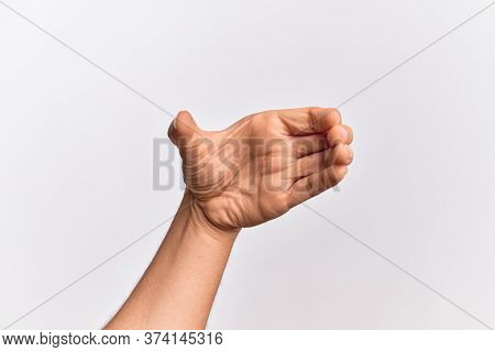 Hand of caucasian young man showing fingers over isolated white background holding invisible object, empty hand doing clipping and grabbing gesture