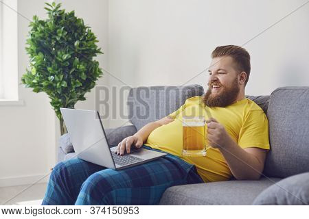 Online Conference Video Call Chat. Online Party With Friends. Funny Man Holds A Glass With Beer, Com