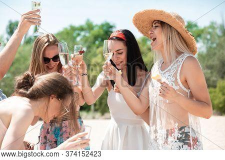 Cheers, Clinking Glasses. Seasonal Feast At Beach Resort. Group Of Friends Celebrating, Resting, Hav