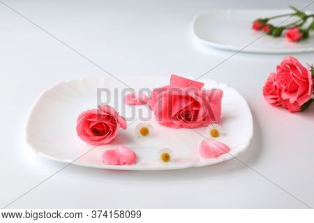 Beautiful Red Rose Flowers On A White Plate Background With Petals, Bouquet, Isolated. Blooming Roma