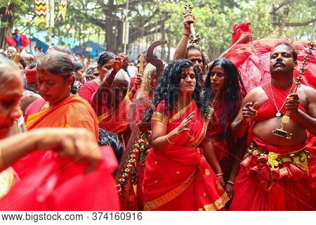 Kerala, India - 23 May 2017: A Frenzied Mob Of Devotees Led By Oracles Walk Around The Temple, Kodun
