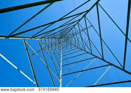 Steel Construction Of A Power Pole And Blue Cloudless Sky