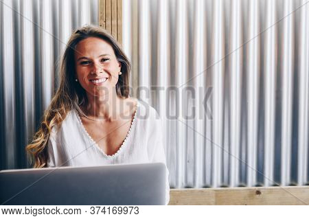 Happy Beautiful Girl Working At Home With Laptop