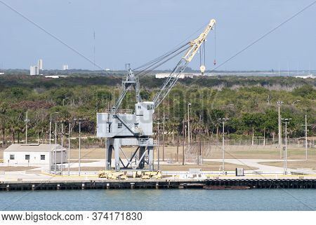 Port Canaveral Crane And Florida's Coastline In A Background (cape Canaveral, Florida).