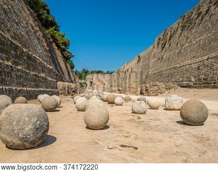 Stone Balls Between Walls of Rhodes Old Town, Greece.