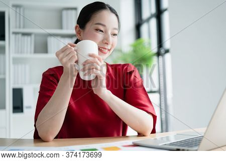 Portrait Of Young Happy Office Woman Having A Coffee Or Tea And Smiling Toward Camera Relax And Happ
