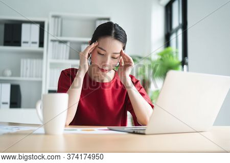 Portrait Of Asian Beautiful Office Woman Having Headaches, Stressful Of Work, Depressed Or Having A