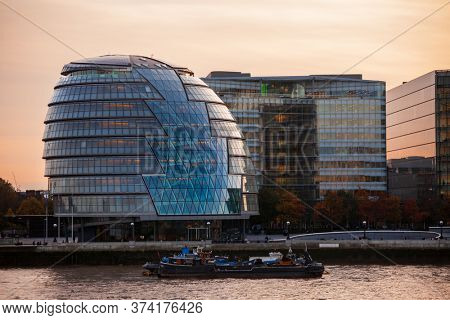LONDON, UK - OCTOBER 30, 2012: Southern bank of the River Thames with City Hall designed by Norman Foster and opened in July 2002